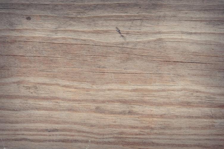 a damaged light hardwood floor